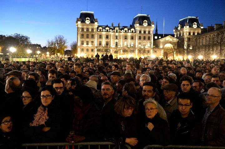 People gather outside Notre Dame Cathedral in Paris on Nov. 15 ahead of a ceremony for the victims of Friday's terrorist