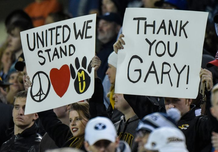 Fans hold up signs showing support for the Missouri Tigers, the University of Missouri and head coach Gary Pinkel on Nov. 14,