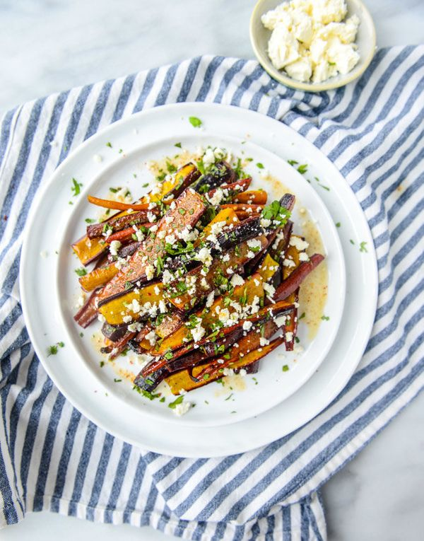 "<strong>Get the <a href=""http://www.howsweeteats.com/2015/10/pomegranate-roasted-carrots-with-feta-and-brown-butter/"" target="