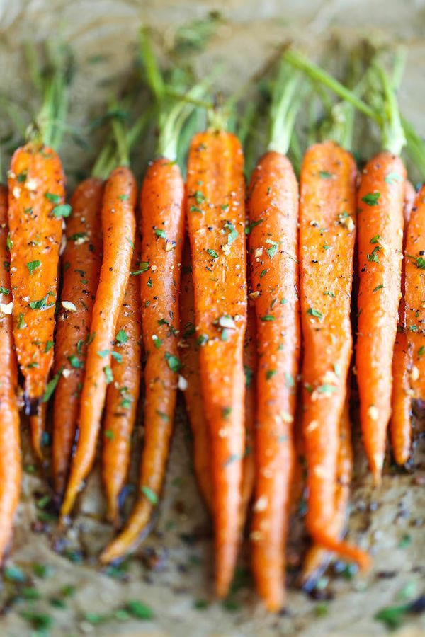 "<strong>Get the <a href=""http://damndelicious.net/2015/01/17/garlic-roasted-carrots/"" target=""_blank"">Garlic Roasted Carrots"
