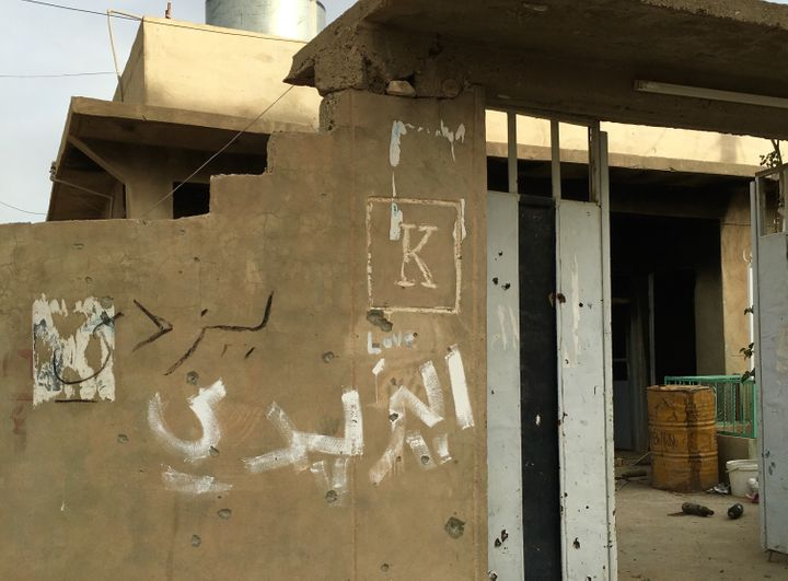 """Yazidi"" written in Arab on the exterior of a family home in Sinjar, Iraq."