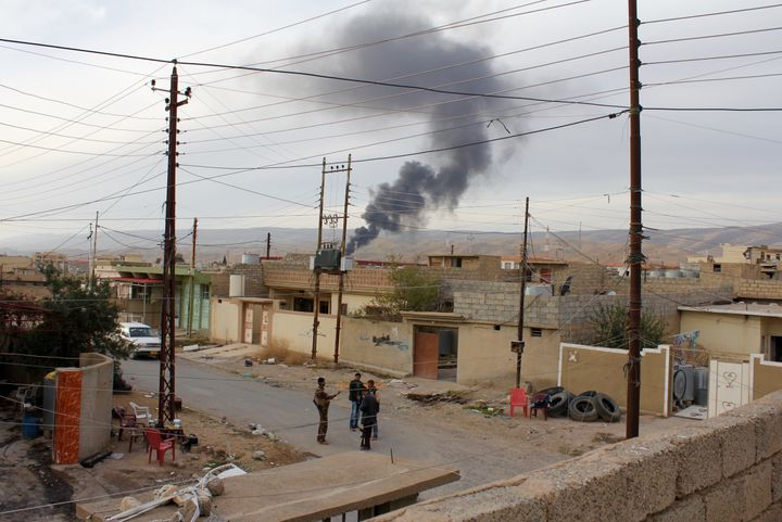 Plumes of smoke rising above Sinjar, reportedly from Yazidi fighters burning the homes of former Sunni inhabitants out of rev