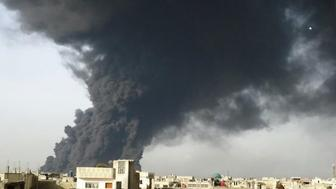 Black smoke over Baba Amr, Homs after jet-fighters bombed oil pipes