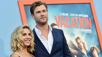 LOS ANGELES, CA - JULY 27:  Actor Chris Hemsworth (R) and his wife model Elsa Pataky arrive at the premiere of Warner Bros. Pictures' 'Vacation' at the Village Theatre on July 27, 2015 in Los Angeles, California.  (Photo by Kevin Winter/Getty Images)