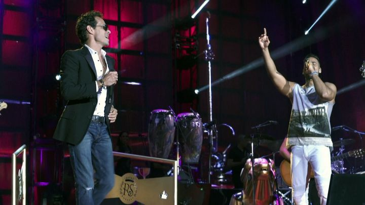 """Salsa singer Marc Anthony performing with Bachata artist Romeo Santos. Their performance was included in the HBO documentary, """"The Latin Explosion: A New America."""""""