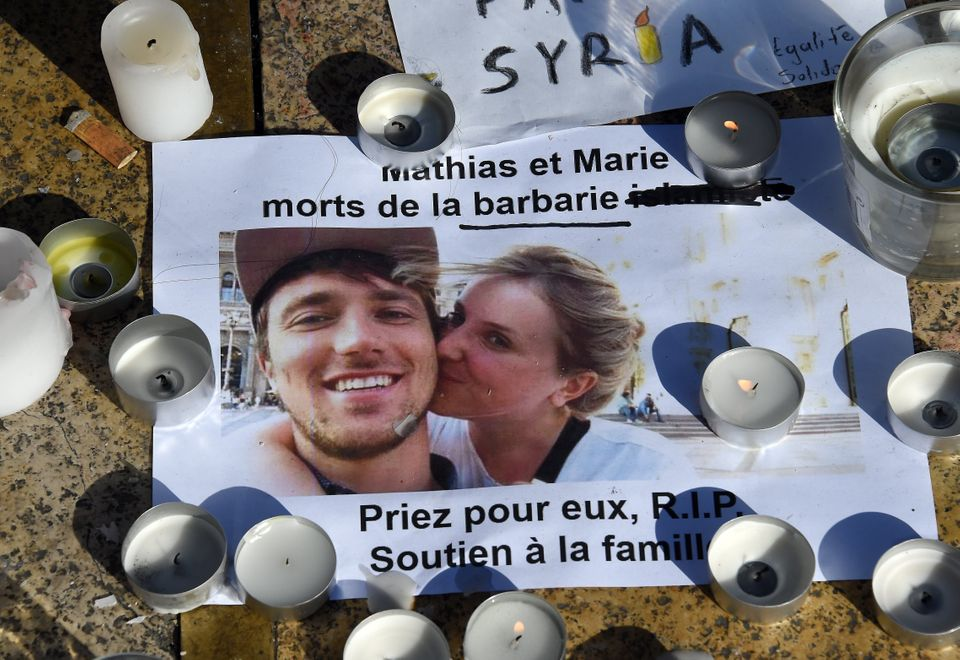 A picture taken on Nov. 16 shows a portrait of Marie and Mathias, victims of the Paris attacks, at the Place de la Comedie in