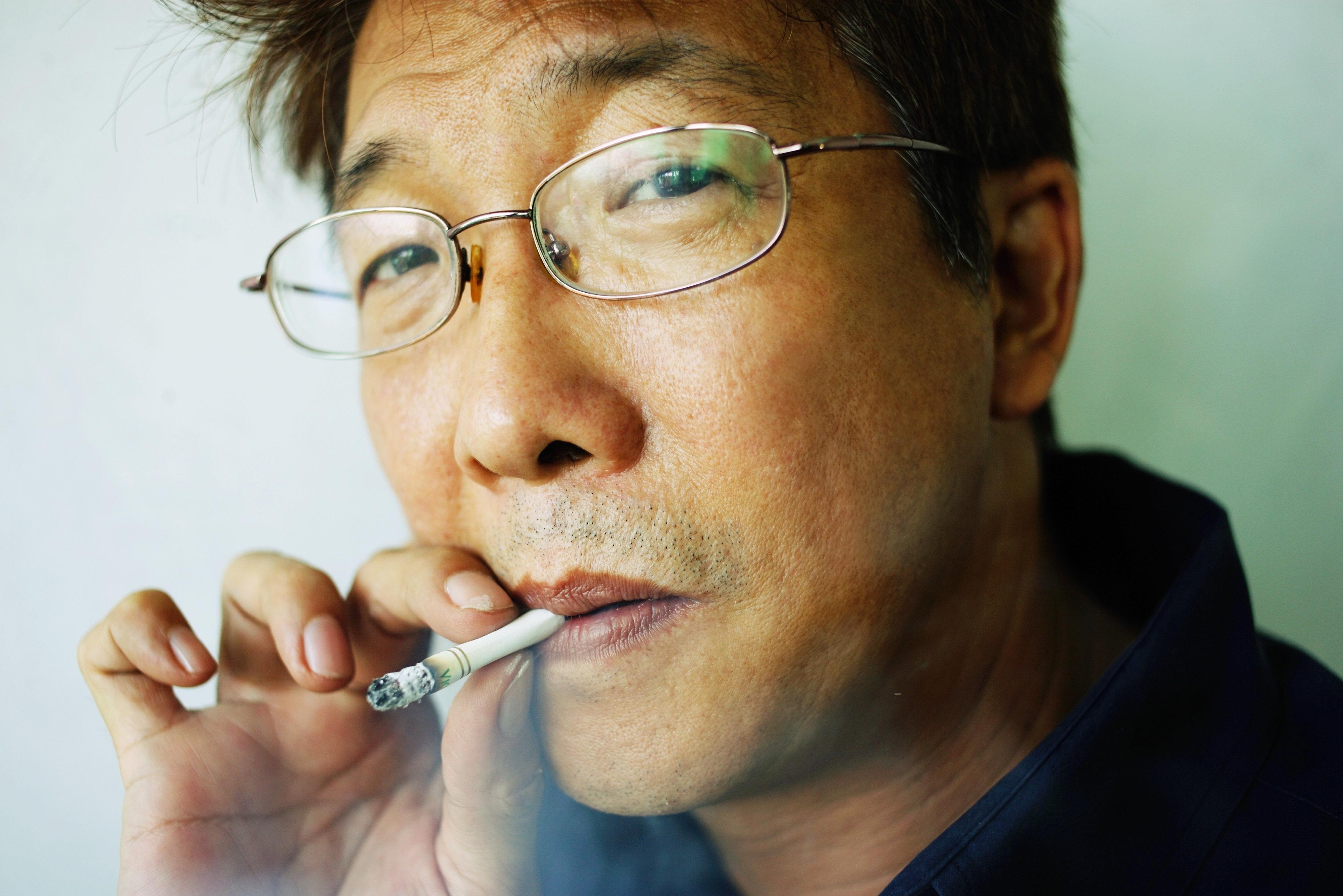 Man smoking cigarette, headshot