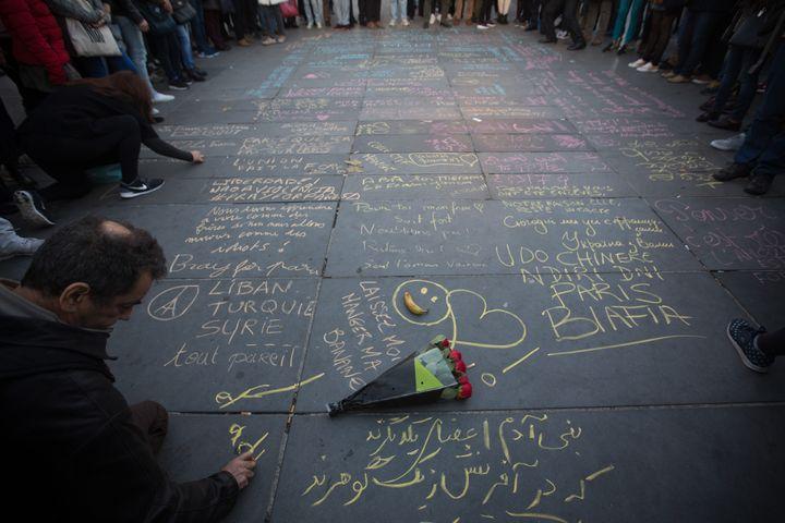 Mourners gathered atPlace de la Republique to write tributes for slain victims.