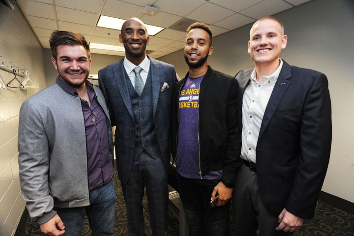 Kobe Bryant #24 of the Los Angeles Lakers poses with Spencer Stone, Alek Skarlatos and Anthony Sadler before the game against