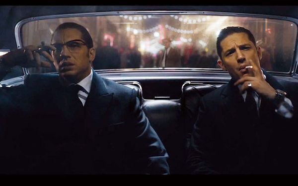 Tom Hardy loves acting with a handicap. A mask covered his face throughout much ofhis two highest-profile moviess