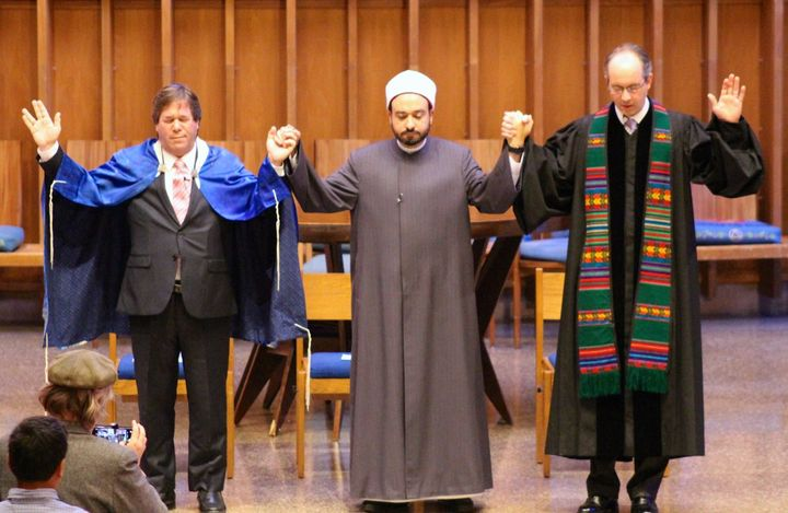 Rabbi Schnitzer, Dr. Tarek Elgawhary and Pastor David Gray pray together during an interfaith service at Bradley Hills Presbyterian Church in Bethesda, Maryland.