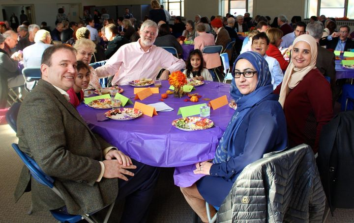 People gathered at Bradley Hills Presbyterian Church share a meal together following the interfaith service.