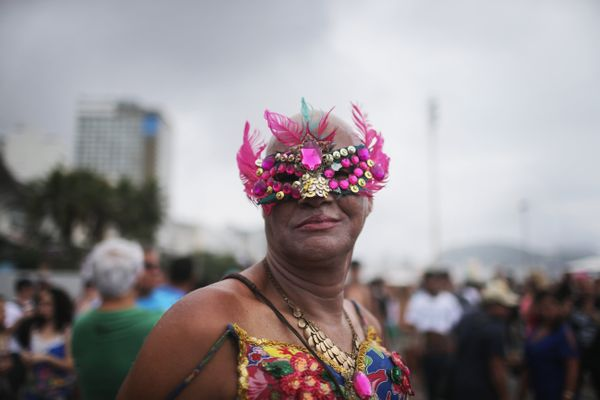 A reveller poses at the annual Gay Pride Parade on November 15, 2015 in Rio de Janeiro, Brazil. Marchers called for expanded
