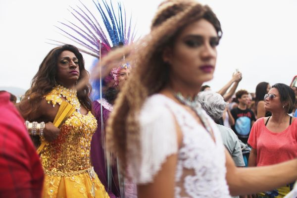 Revellers gather at the annual Gay Pride Parade on November 15, 2015 in Rio de Janeiro, Brazil. Marchers called for expanded