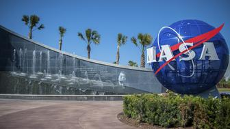 The Kennedy Space Center Visitor Complex is the visitor center at NASAs Kennedy Space Center in Florida. It features exhibits and displays, historic spacecraft and memorabilia, shows, two IMAX theaters, a range of bus tours of the spaceport, and the Shuttle Launch Experience, a simulated ride into space. It also encompasses the separate Apollo/Saturn V Center and United States Astronaut Hall of Fame. There were 1.5 million visitors in 2009 and it had some 700 employees.