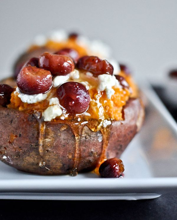 """<strong>Get the <a href=""""http://www.howsweeteats.com/2012/01/roasted-grape-goat-cheese-honey-stuffed-sweet-potatoes/"""" target="""