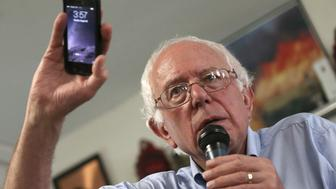 CLINTON, IA - AUGUST 16:  Democratic presidential candidate U.S. Sen. Bernie Sanders (I-VT) holds up his mobile phone while answering a question about privacy issues during a campaign event at the IAFF Local 809 Union Hall August 16, 2015 in Clinton, Iowa. Sanders was scheduled for a full day of campaigning in eastern Iowa today.  (Photo by Win McNamee/Getty Images)