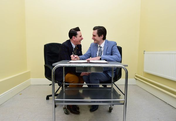 Newly married couple Richard Dowling (L) and Cormac Gollogly (R) sign the registry book as the first ever same sex marriage t