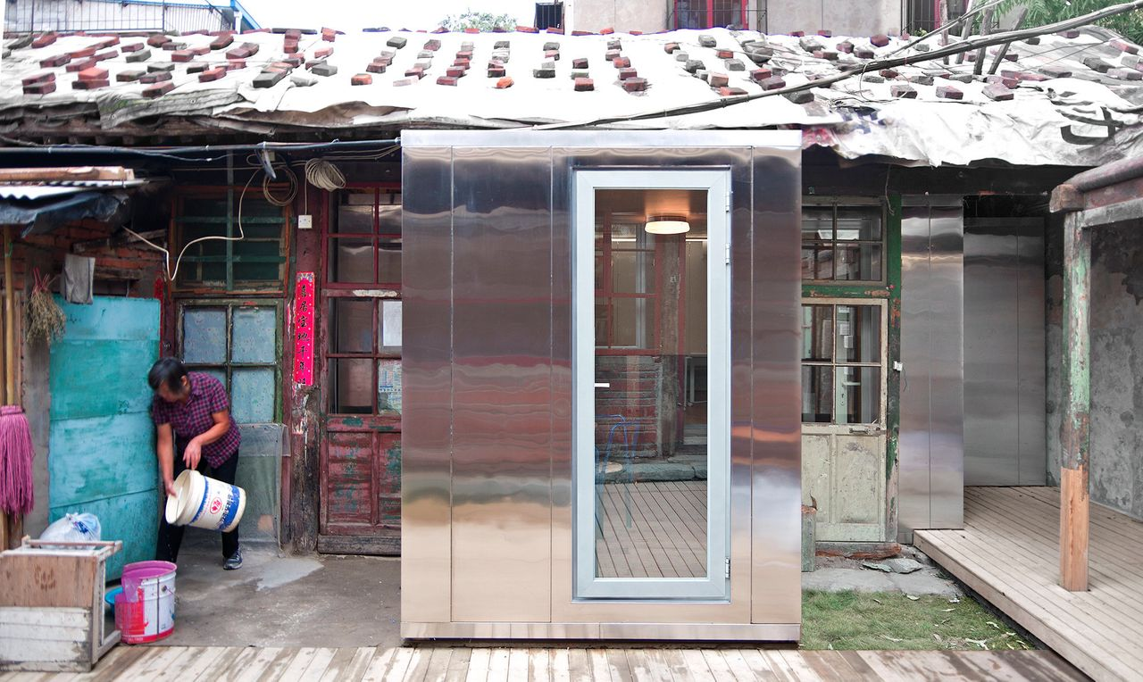 """""""The Courtyard House Plugin is essentially a house within a house,"""" the architects explained in a statement. """"It is a prefabricated modular system designed to bring modern living standards and energy efficiency to buildings that are centuries old while keeping them fully intact."""""""