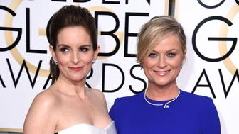 BEVERLY HILLS, CA - JANUARY 11:  Tina Fey and Amy Poehler arrives at the 72nd Annual Golden Globe Awards at The Beverly Hilton Hotel on January 11, 2015 in Beverly Hills, California.  (Photo by Steve Granitz/WireImage)