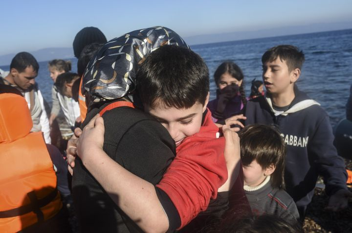 A Syrian family arrive with other migrants and refugees on the Greek island of Lesbos after crossing the Aegean Sea from Turk