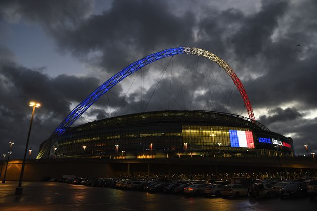 """<span class='image-component__caption' itemprop=""""caption"""">The Wembley Stadium arch is lit up with the colours of the French flag before the International Friendly match between England and France.</span>"""