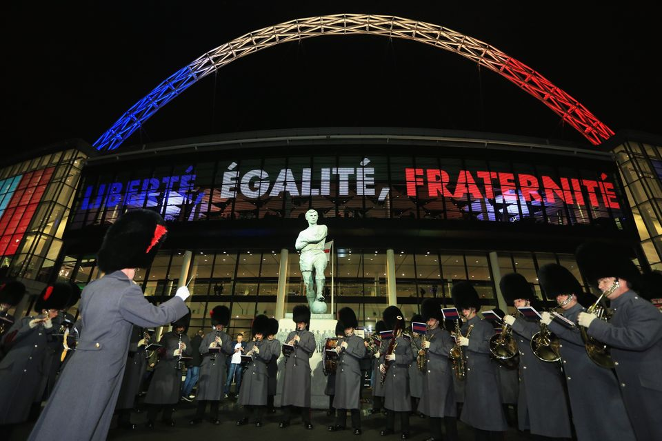 LONDON, ENGLAND - NOVEMBER 17:  A military band plays infront of the Bobby Moore statue stands  prior to the International Fr