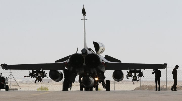 France stepped up airstrikes against the Islamic State, striking its bases in Raqqa.
