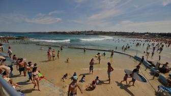 People enjoy the hot weather at Bondi Beach during the Labour Day holiday in Sydney on October 5, 2015.   AFP PHOTO / Peter PARKS        (Photo credit should read PETER PARKS/AFP/Getty Images)