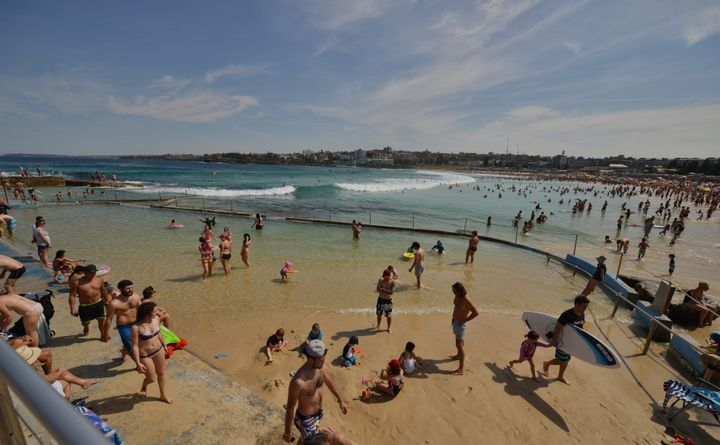 People enjoy the hot weather at Bondi Beach during the Labour Day holiday in Sydney in October 2015.