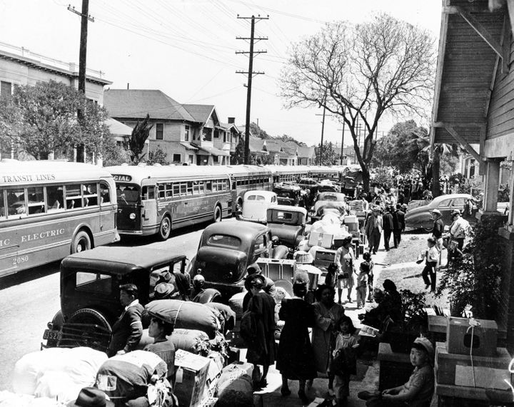 This 1942 photo shows the evacuation of American-born Japanese civilians during World War II, as they leave their homes for i