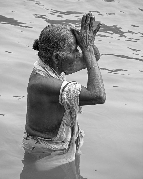 """A woman bathes in the Ganges, a holy river inAllahabad, India. Hindus believe <a href=""""http://www.usatoday.com/story/ne"""