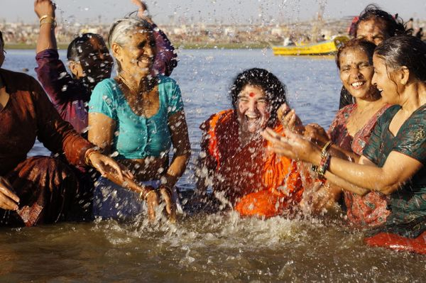 "A group of women enjoy a moment of laughter in <a href=""http://uttarakhandtourism.gov.in/utdb/?q=deoprayag"">Devprayag</a>, th"
