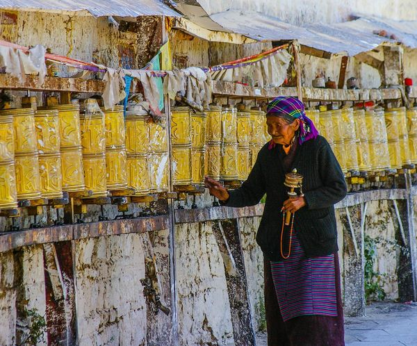 "A Tibetan woman <a href=""http://www.gettyimages.com/detail/video/people-spinning-prayer-wheels-lhasa-tibet-china-stock-footag"
