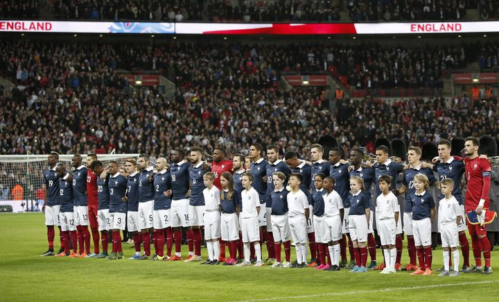 The France squad link arms before the start of the friendly football match between England and France at Wembley Stadium in w