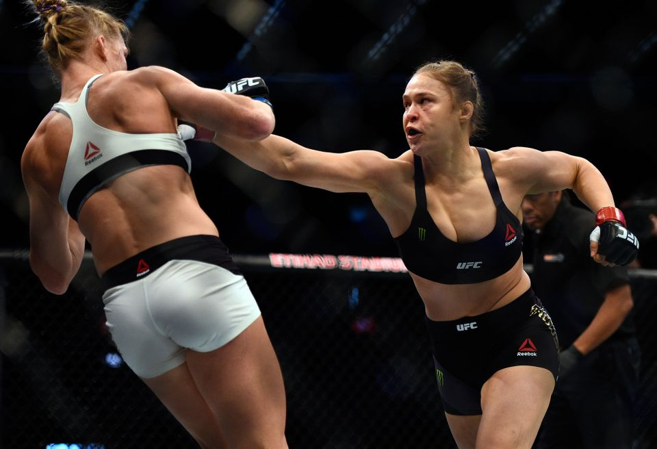 MELBOURNE, AUSTRALIA - NOVEMBER 15: (R-L) Ronda Rousey punches Holly Holm in their UFC women's bantamweight championship bout