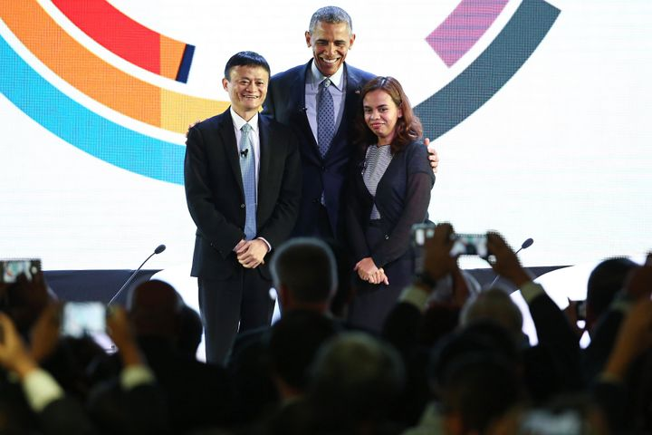 Obama, center, poses for a photograph with billionaire Jack Ma, left, and engineer Aisa Mijeno, co-founder of Salt (Sustainab