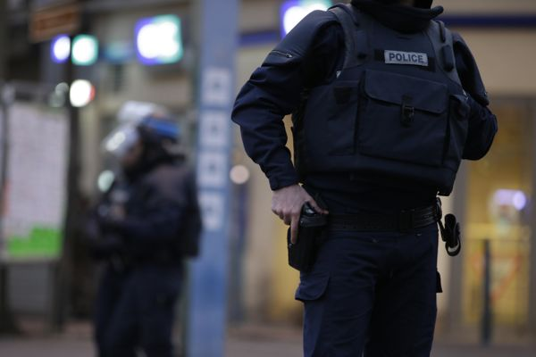 Members of French police special forces stand guard.