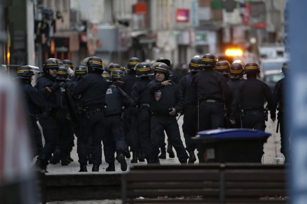 Policemen take up a combat position.