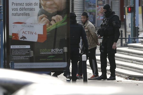 A man is evacuated after being arrested by police.