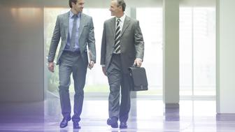 Businessmen talking in office lobby