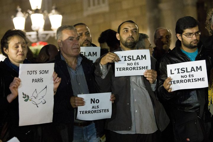 Muslims from Spain gather to condemn Friday terror attacks in Paris by lighting candles at Placa Sant Jaume in Barcelona