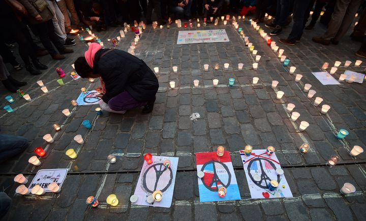 Hundreds of people flocked to the Molenbeek area in Brussels, Belgium, to honor the lives lost in Paris with a candlelight vi