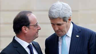PARIS, FRANCE - NOVEMBER 17:  French President Francois Hollande (L) welcomes US Secretary of State John Kerry prior to a meeting at the Elysee Presidential Palace on November 17, 2015 in Paris, France. John Kerry arrives in Paris to pay tribute to victims of last week's terrorist attacks.  (Photo by Chesnot/Getty Images)