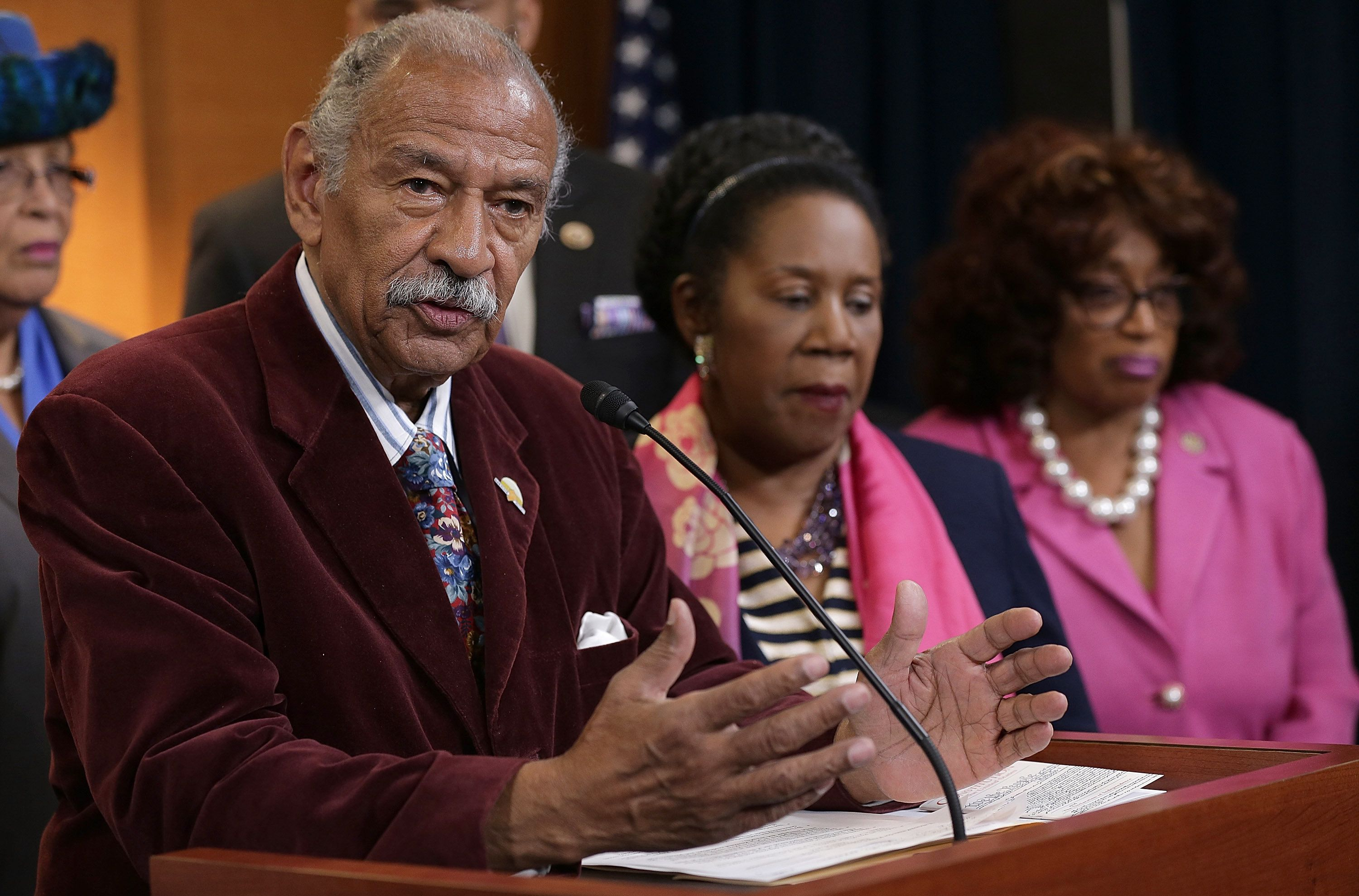 WASHINGTON, DC - MARCH 19:  Rep. Rep. John Conyers (L) (D-MI) joins other House Democrats at a press conference calling for a Senate vote on the nomination of Loretta Lynch to be the next Attorney General March 19, 2015 in Washington, DC. Lynch's nomination has languished in the U.S. Senate for 21 days since her nomination was passed out of the Senate Judiciary Committee. Also pictured is Rep. Shelia Jackson Lee (2nd R) (D-TX). (Photo by Win McNamee/Getty Images)