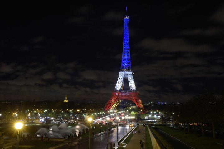 The Eiffel Tower illuminated on Nov. 17, 2015, with the French national colors in tribute to the victims of the Paris terror