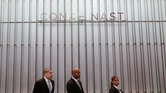 Employees are stated at the front desk for Conde Nast in the lobby of One World Trade Center Monday, Nov. 3, 2014 in New York. Thirteen years after the 9/11 terrorist attack, the resurrected World Trade Center is again opening for business, marking an emotional milestone for both New Yorkers and the United States as a whole. Publishing giant Conde Nast will start moving Monday into One World Trade Center, a 104-story, $3.9 billion skyscraper that dominates the Manhattan skyline. It is America's tallest building. (AP Photo/Mark Lennihan)