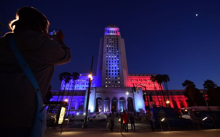 The Los Angeles City Hall is lit withthe colors of the French flag on November 17, 2015 as Mayor Eric Garcetti was join