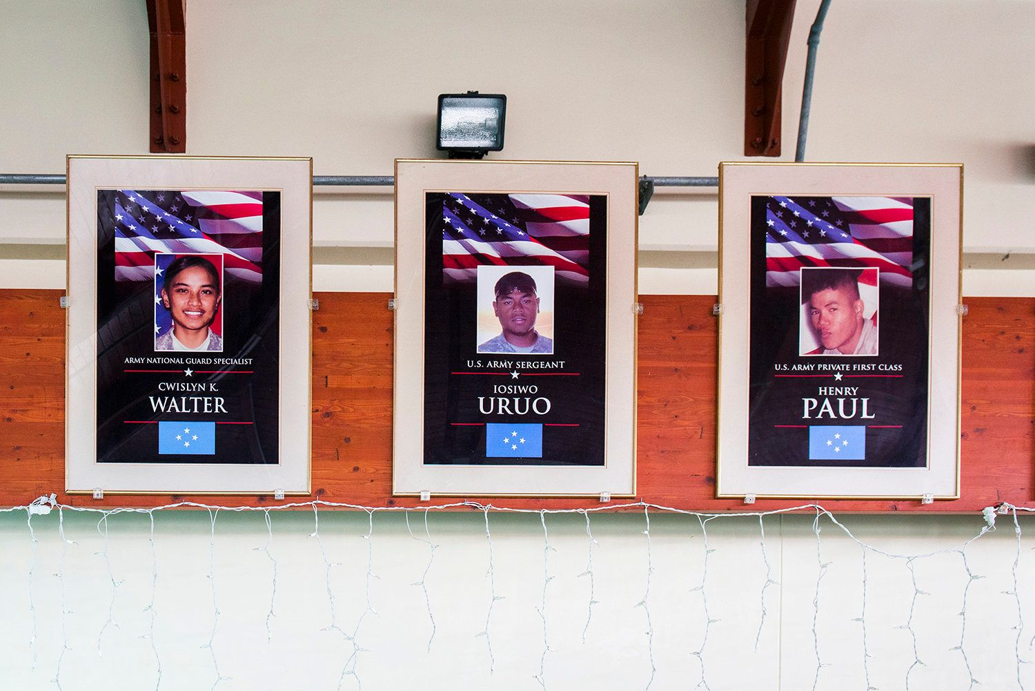Portraits of fallen Micronesian soldiers hang at the airport on Pohnpei. Both U.S. island territories as well as U.S.-affiliated Micronesian island nations have high per capita rates of deaths in the military.