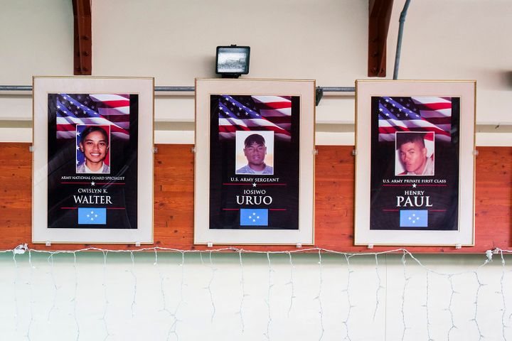 Portraits of fallen Micronesian soldiers hang at the airport on Pohnpei. Both U.S. island territories as well as U.S.-affilia